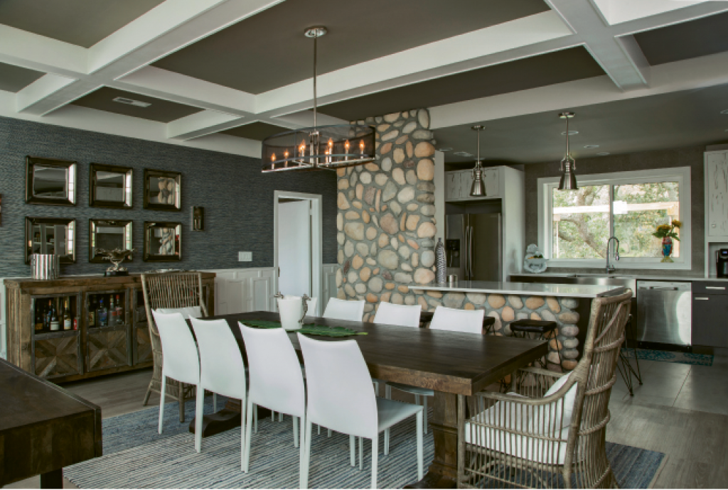 Open Up: The closed galley kitchen was opened up to bring in the boulevard view and mingle with the main living and dining areas. Creative elements like river rock and crisp, white pecky cypress cabinets carry the Warren design stamp.