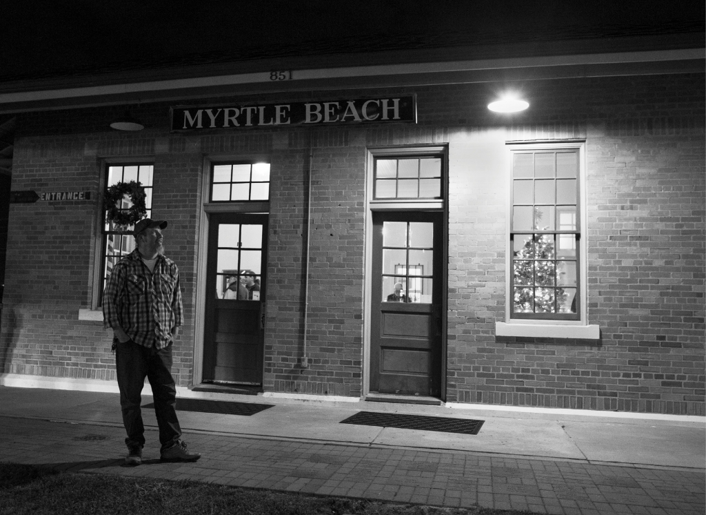 After sound check at the SXSE show on Saturday, December 3, 2016, current SXSE president Seth Funderburk takes a break outside the Myrtle Beach Train Depot before the Randall Bramblett show.