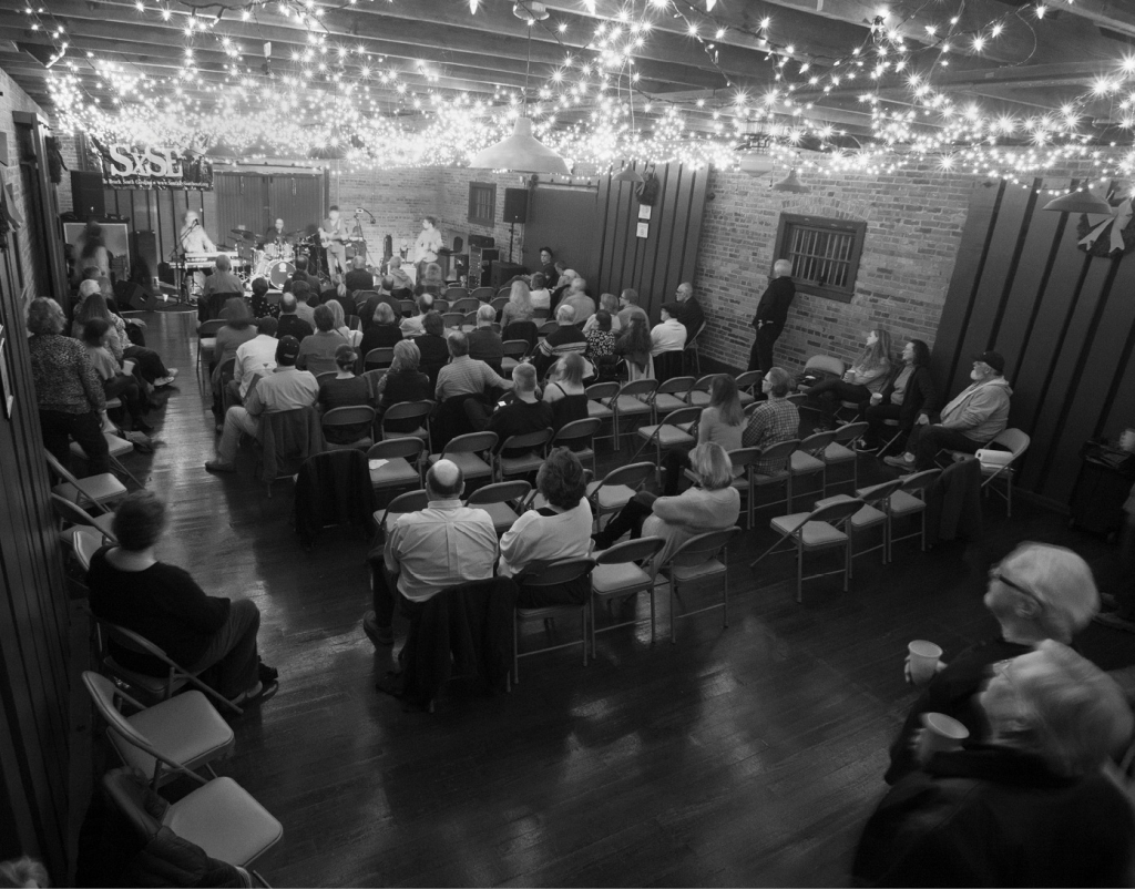 The crowd settles before the start of the second set of an appearance of The Randall Bramblett Band at SXSE on December 3, 2016.