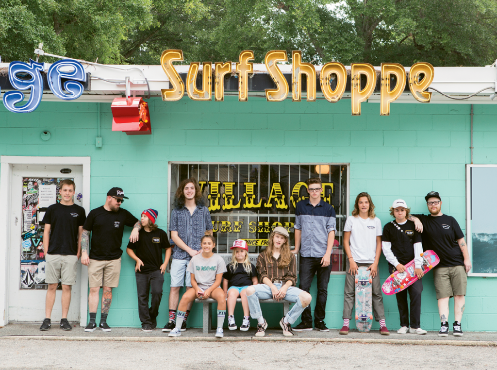 """Village Surf Shoppe is home to Ten Twenty-five, a skateboard team and youth mentorship program led by Village employee Aaron Wright. Pictured are (from left) Parker Nance, Brian Campbell, Alex MacNeil, Andrew Simpson, Lexie Latta, Rensley Wright, Jacob """"J Byrd"""" Byrd, Stephen Griffin, Jesse Ford, Bret """"Bronco"""" Todd and Aaron Wright."""