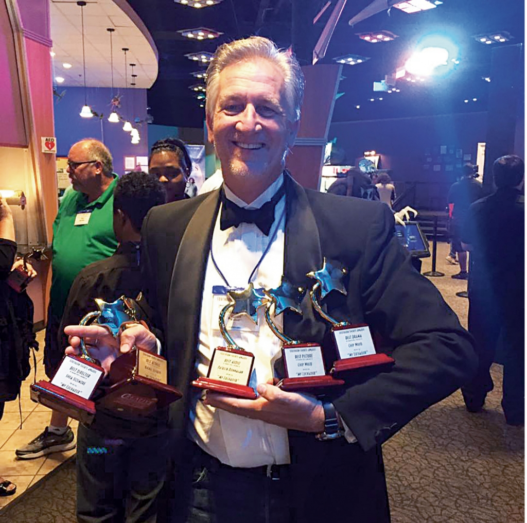 Chip White holds a handful of hardware—five awards at the Southern Shorts Awards Film Festival in Roswell, Ga., for My Luchador