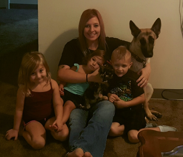 The happy family after being reunited included children Zoie Ann, Scarlett Autumn and Kingston Anthony with mom Amanda Newcomer and Astrid and a new kitten