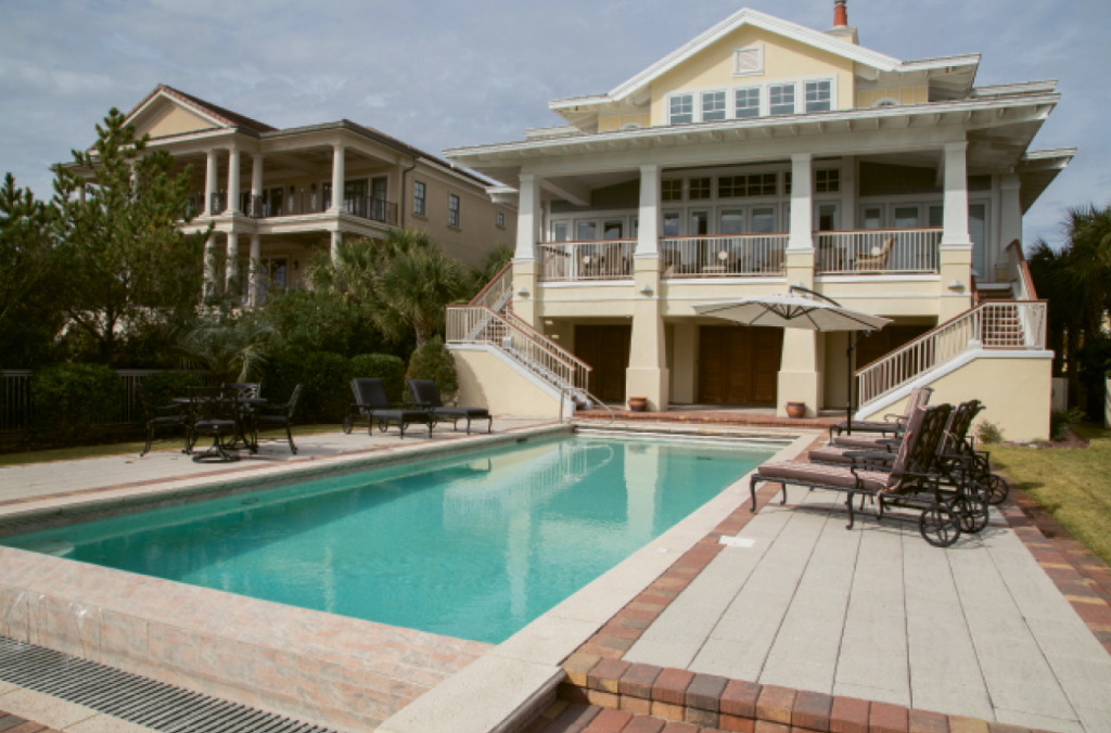Come On Outside: Besides the beach being only steps from the back porch, the Pettus home features a swimming pool and lounger patio plus a second story covered porch for serious parties.