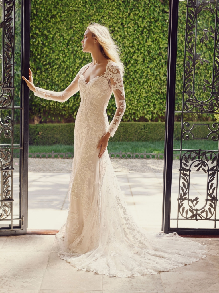 Lace Tattoo Sophisticated, carefree and elegant all in one romantic gown. The long lace train and elaborate applique sleeve detail give this Casablanca dress a modern look to a timeless silhouette for your wedding.  Amanda's Collection, $1,280