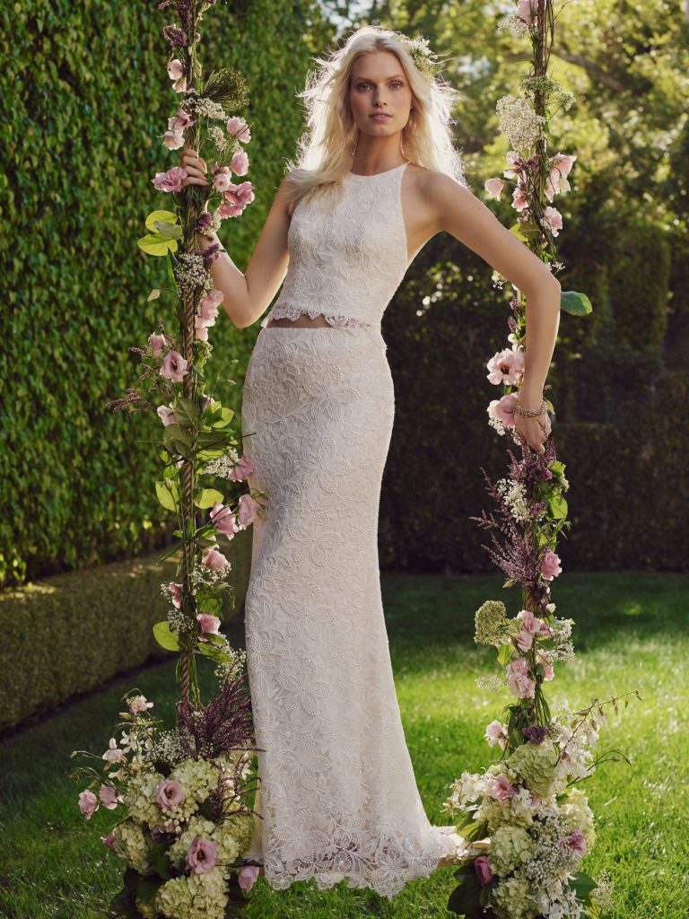 Organic Love  On trend for 2016, the peek of bare midriff is revealed with this unique two-piece Casablanca sheath gown finished with a high neck top and organic leaf motif edging. Amanda's Collection, $1,440