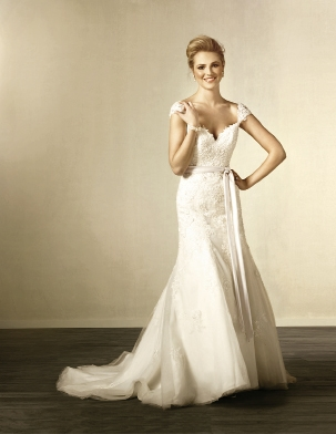 Alfred Angelo: With the country chic style in full bloom, this gown looks as though it was pulled from grandmother's trunk and made super sensuous with the low-cut back and sweep train. Style 2440. Amanda's Collection, $1,149