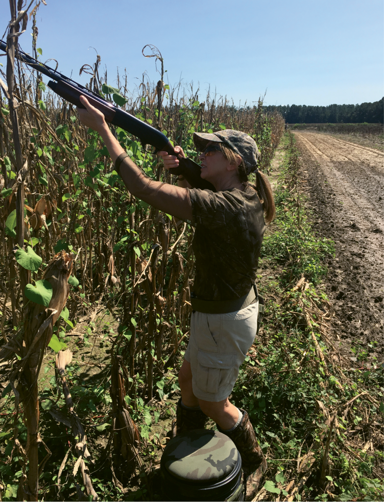 Boineau takes aim while dove hunting at Honey Camp Dove Club.