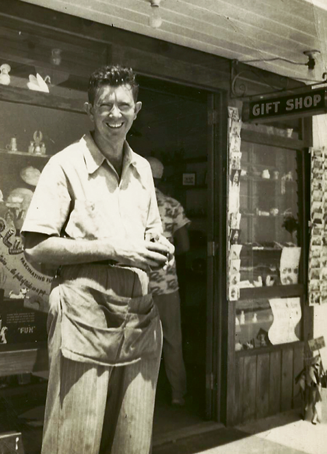 Buz's father, Justin W. Plyler, stands in front of the Gay Dolphin Gift Cove in 1950.