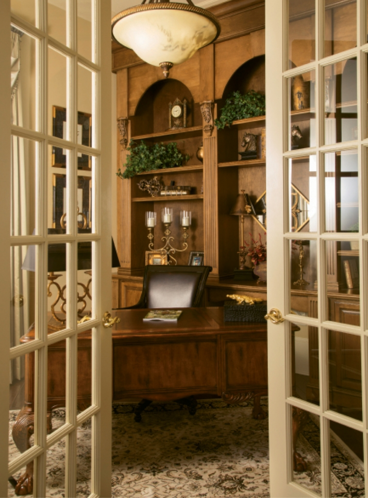 "Study Time: Height, rather than width, defines the elegant study/office space that Nancy had refinished in wood. From the French doors to the shelved accessories, it is a ""case study"" in design editing."