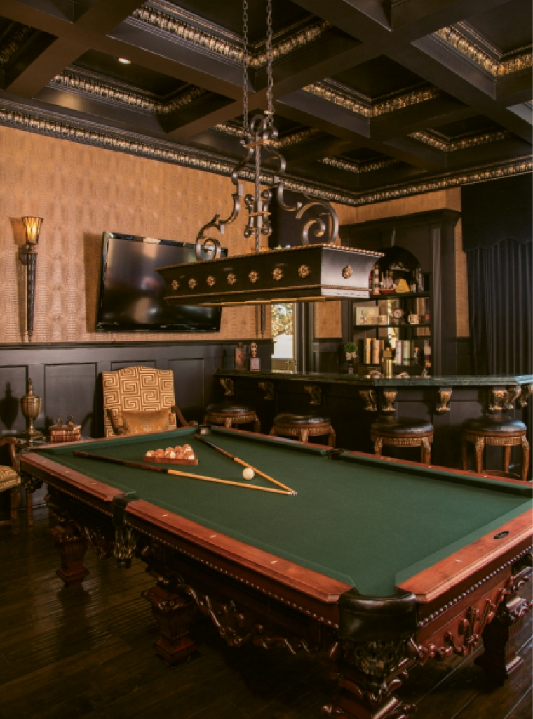 "R&R: Need a little rest and relaxation? Here, you can unwind in ""The Club Room"" with a game of billiards and perhaps a snifter of brandy. And, opposite page, who wouldn't love to curl up in this chocolaty master bedroom suite?"