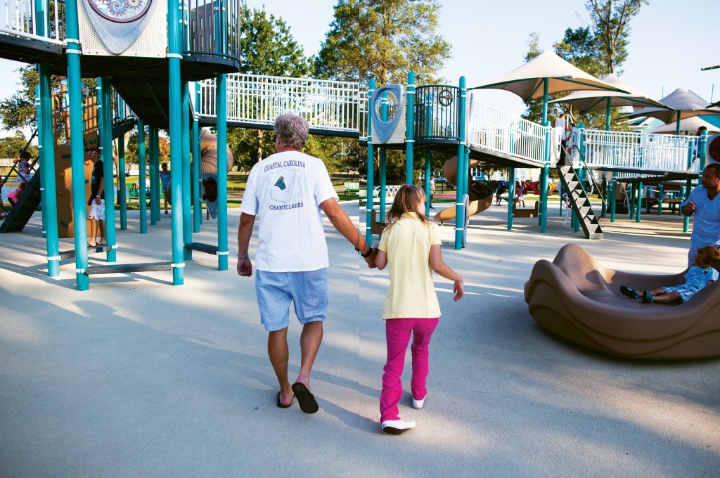 Savannah Thompson and her father, Lance, check out the playground facilities, which rubberized surfaces, plenty of shade and specially engineered equipment designed for special needs and able-bodied children to use together.