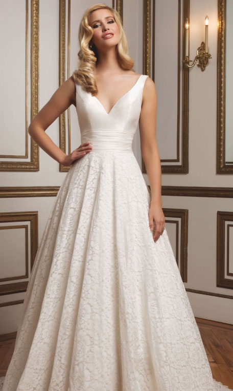 grace Glamour Create an ambiance of 1950s glamour with this silk Dupion V-neckline Justin Alexander  ballgown with fitted bodice, pleated cummerbund and  finished hem lace.  The Little White Dress, $1,533