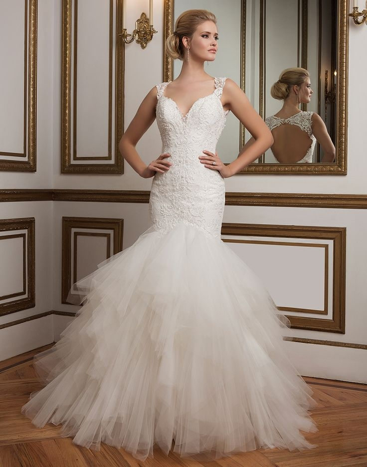 Leading Lady Jaws will drop with the sophisticated drama of this beaded Chantilly lace Justin Alexander gown featuring a deep V-neckline, lace straps, a tulle handkerchief mermaid skirt and a deep keyhole back. The Little White Dress, $1,733