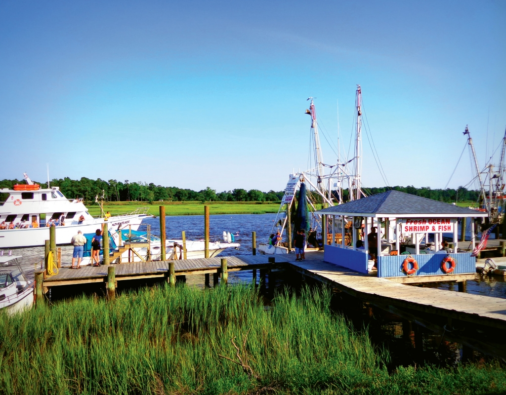 An always-active Calabash waterfront is populated by seafood shacks, bait shops, fishing boats and restaurants.