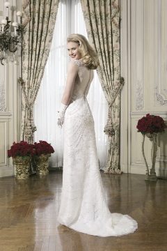 Justin Alexander  This embroidered beaded tulle straight dress with V-neck features a low, open back.  The Little White Dress, $2,115