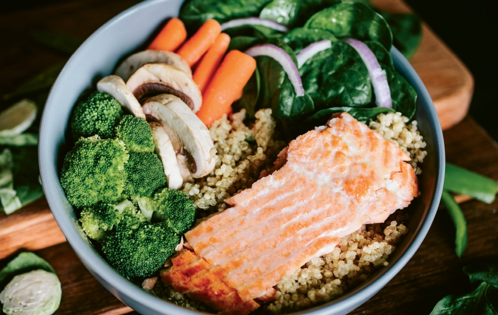 Build your own bowl at Clean Eatz with choices of proteins, vegetables, carbs and sauces.