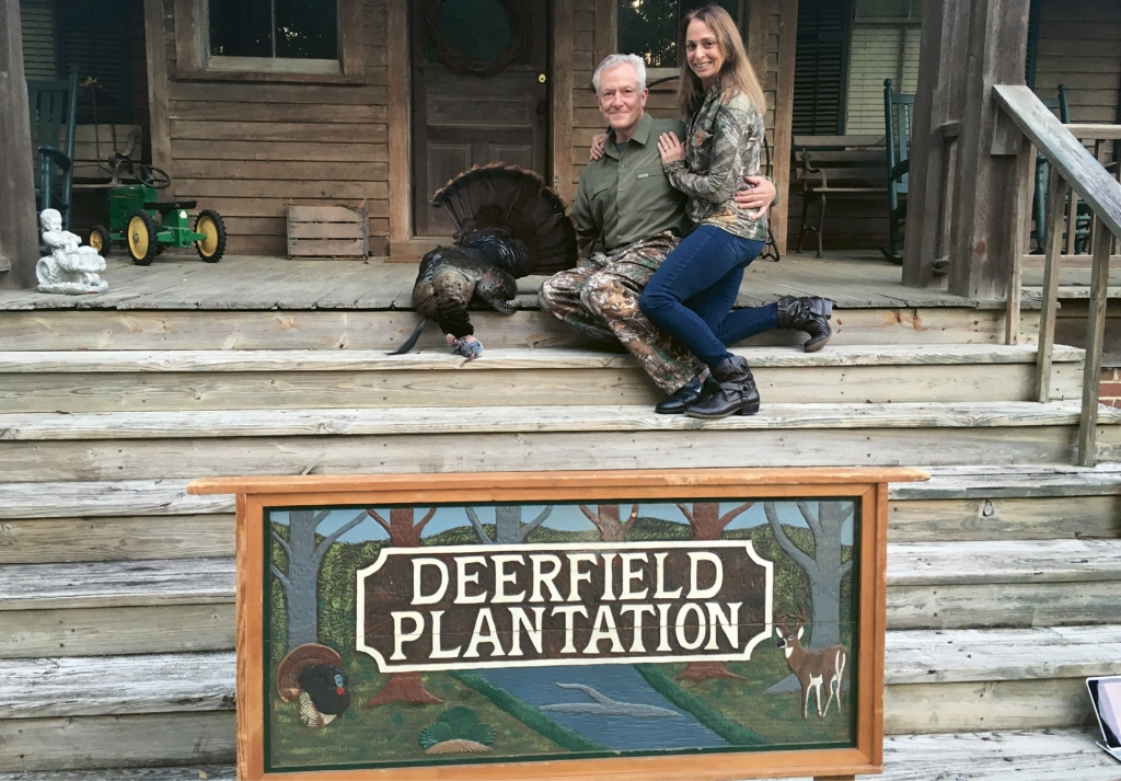 The couple pose after a hunt at Deerfield Plantation in St. George, S.C.