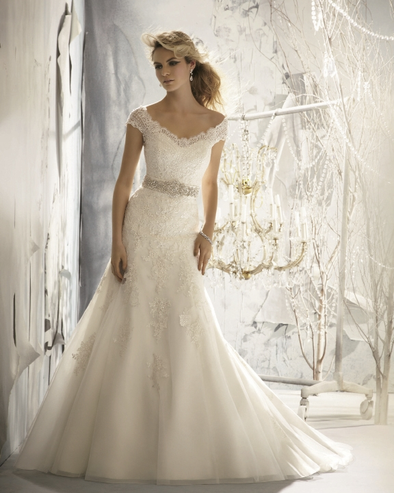 Mori Lee: Delicate Alencon lace on net highlights this beautiful gown that includes  a removable crystal-beaded satin belt.  Style 1960. Fancy Frocks, $1,323