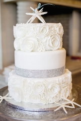 RED VELVET & WHITE RUSSIAN: For Zacquekine Doyle's wedding to Dwayne Wright, they chose two cake flavors and gray lace piping on the bottom layer to match the dress. Crossants Bistro & Bakery delivered the cake of their dreams.
