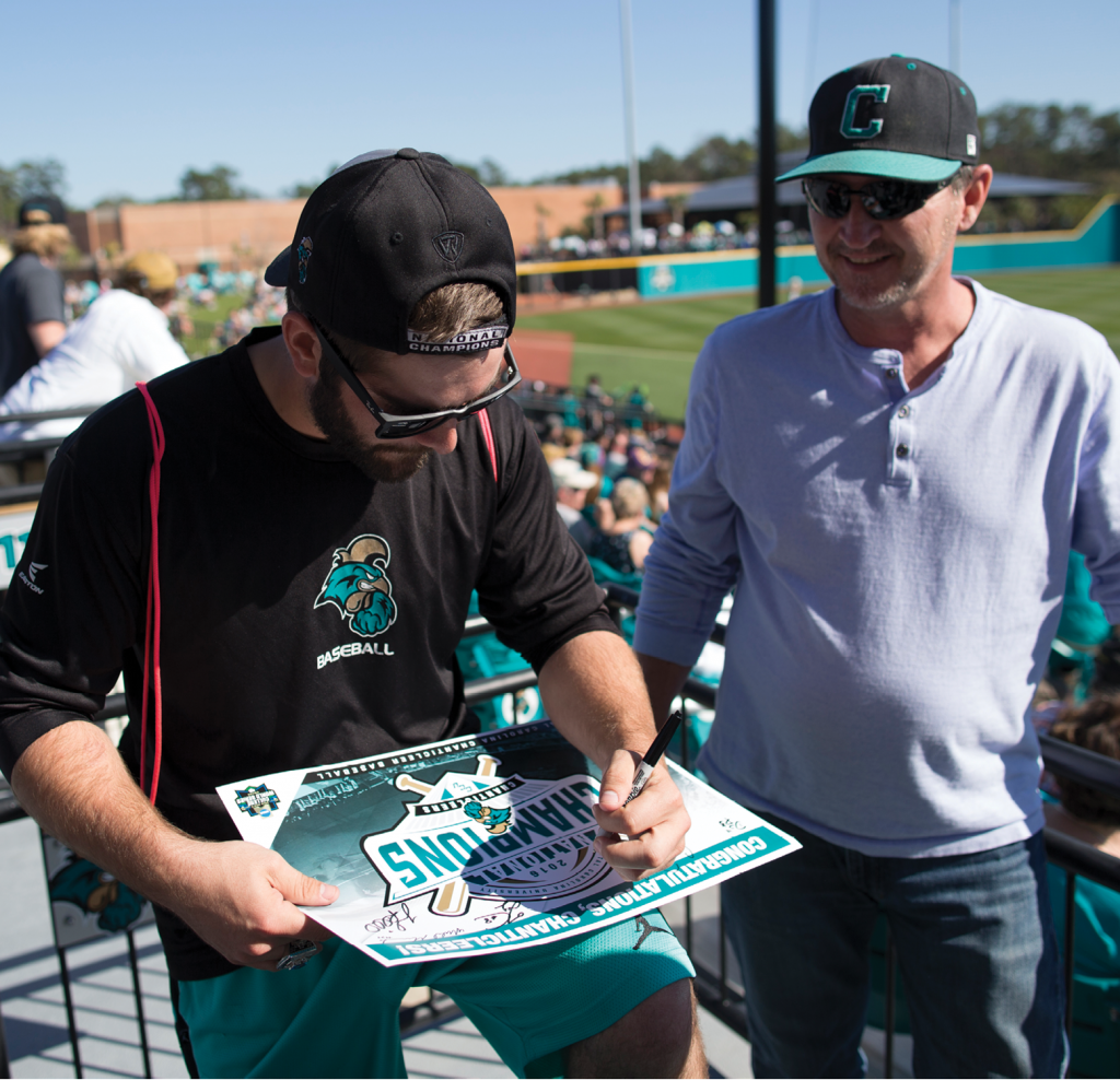 Anthony Marks signs an autograph for a CCU fan.