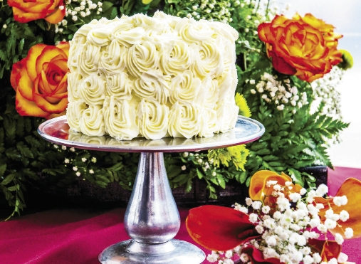 CASCADING PEONIES: Christina Davis has a passion for peonies, and for her wedding to Jarred Ingram she wanted an all-white pound cake with peonies cascading down the side. Pawleys Island Bakery designed this unique cake.