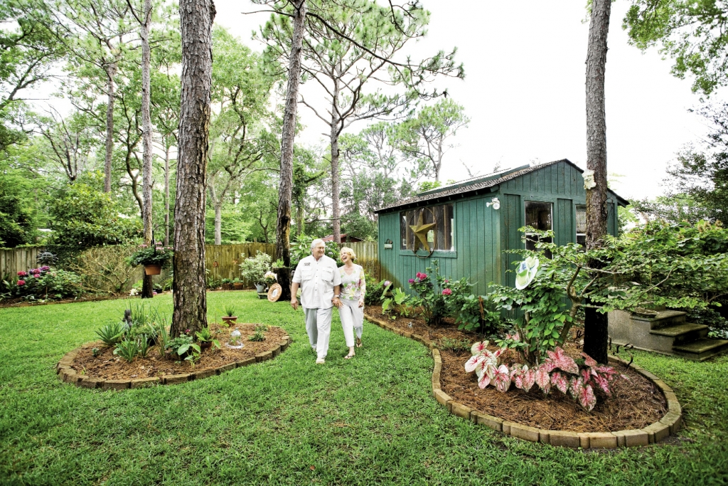 Freddie and Martha Knight take a stroll through their perfectly manicured gardens, complete with a potting shed.
