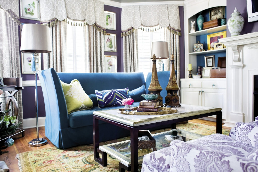 A pair of teal sofas in the family room speak to lavender damask chairs.