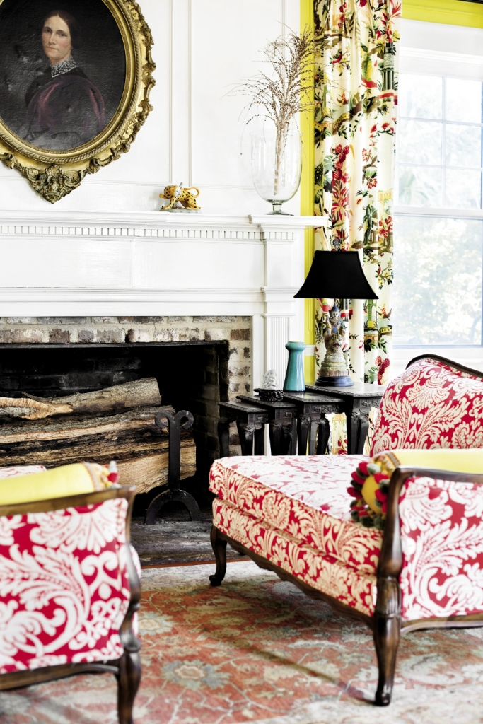 The entry and main room at Estherville Plantation is decorated in bold Colonial colors and striking fabrics