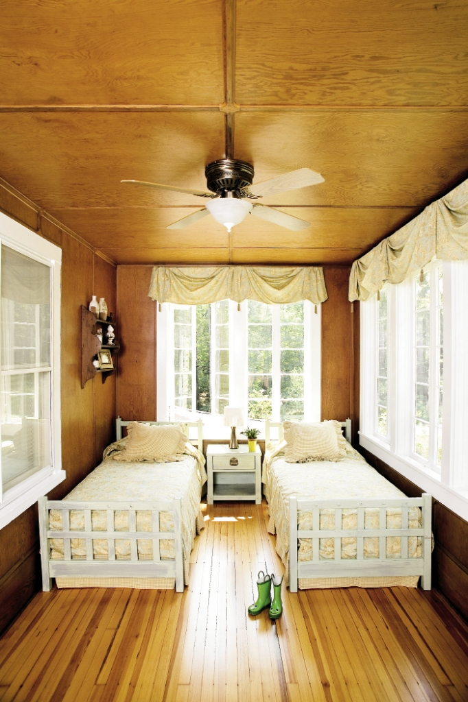 The original sleeping porch has been perfectly restored to become a charming guest room for sleep-overs