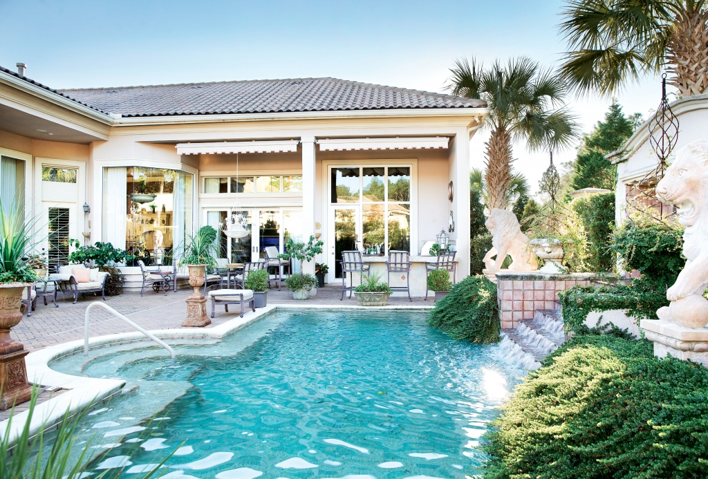 The Tozzoli Home: Under the careful eye of the pair of solid marble lions, this backyard beauty at the Tozzoli home has everything you could dream of  under the Carolina sun, from waterfall and pool to an outdoor kitchen to a large lounge and patio area for Cindy's summertime socials.