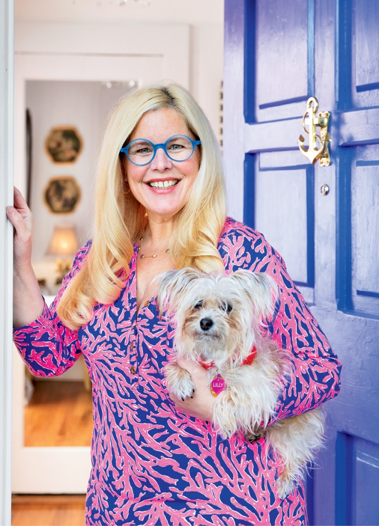 The Battleson Home: Kendall, clutching her maltese, one of five furry friends, says her day's moment of peace is spent on her second floor enclosed porch that provides an ocean peek.