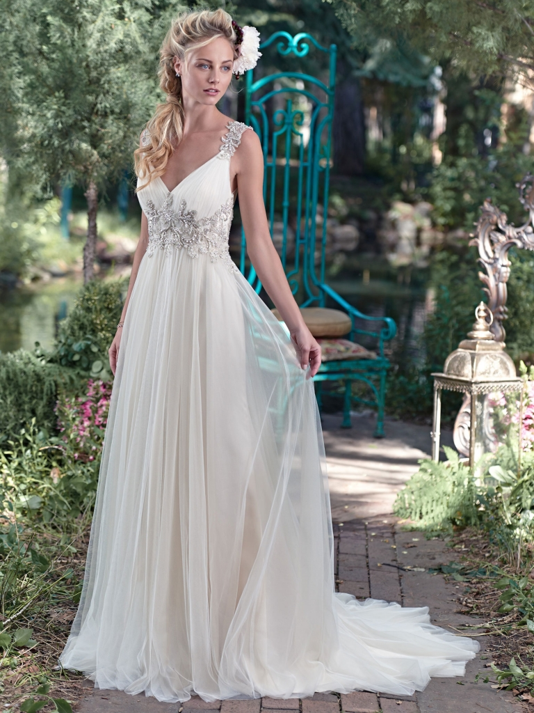 Boho royalty Romance is found in this stunning Maggie Sottero tulle sheath dress with plunging neckline and sparkling Swarovski crystal embellishment. Intricate patterns of beaded embroidery dance along the shoulder and lead to a dramatic illusion back. Fancy Frocks, $1,479