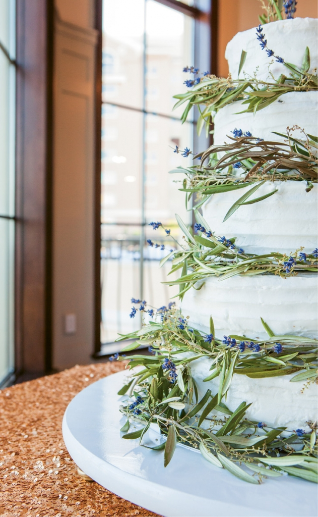 Stunning Details: Gorgeous Greek icons were woven into the Greek olive wreaths that wrapped the tiered cake