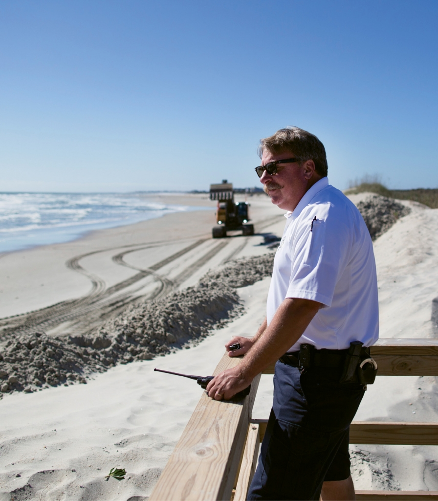 Mike Fanning checks in on beach reclamation efforts as part of his daily rounds as Chief of Police at Pawleys Island.