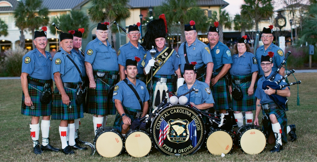 The Coastal Carolina Shields Pipe and Drum Band make a stunning presence in their finest dress uniforms.