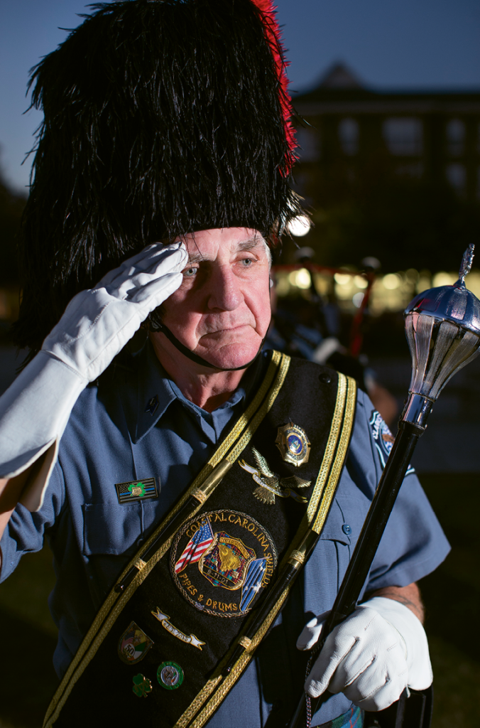 Drum Major Harry Baumann, a retired officer from the Clarkstown, N.Y., police force.