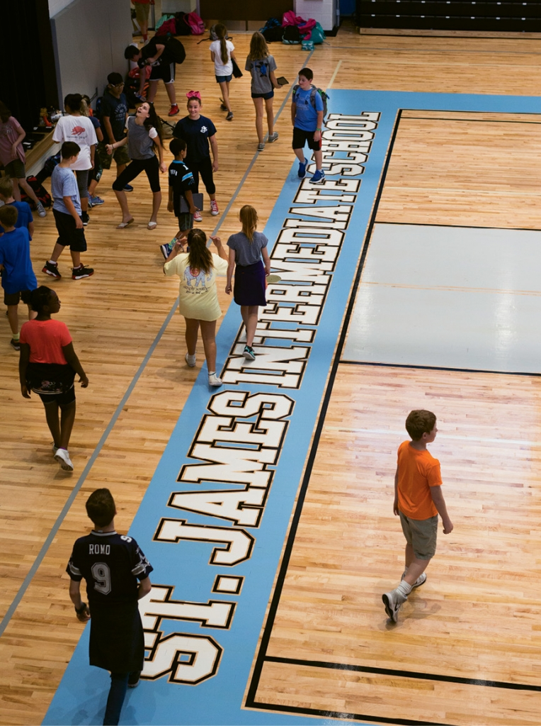 Students participate in gym class in the new gymnasium