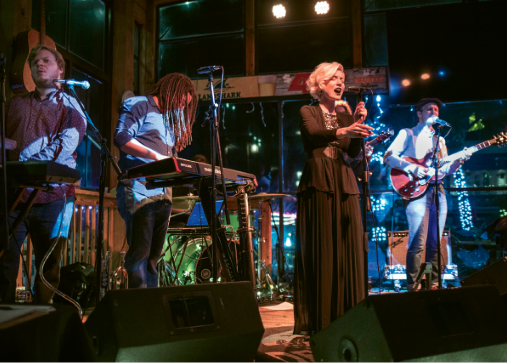 Liz Kelley-Tavernier, (center) vocalist for Oracle Blue, performs with the band at the Dead Dog Saloon in Murrells Inlet.