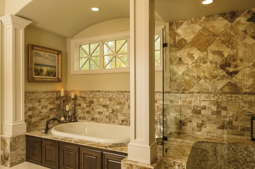 Details, Details: The master bathroom is a retreat all its own with architectural detailing, woodwork and gorgeous tile design.