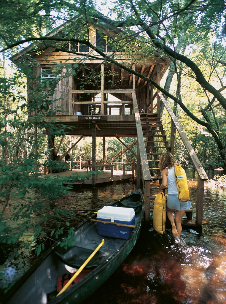 Treehouses accommodate two to eight guests and are constructed with locally harvested materials.