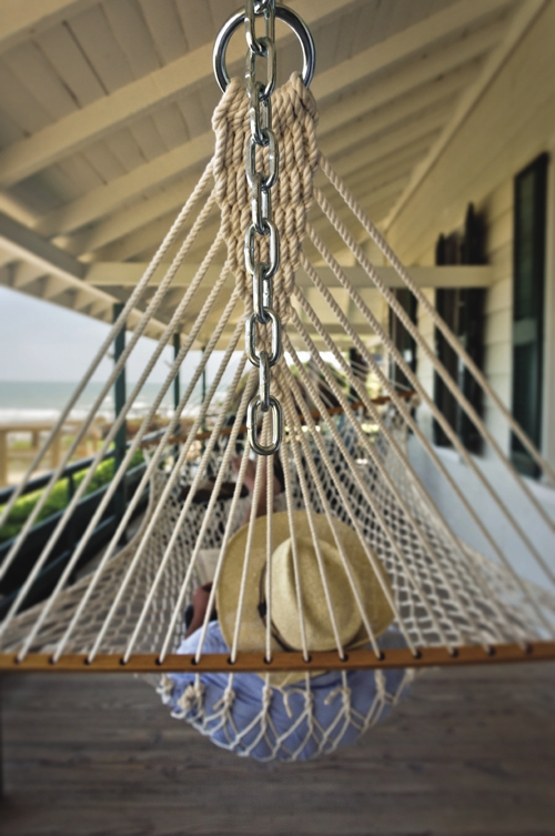 The writer enjoys a moment of blissful leisure in Pawleys Island.