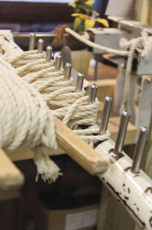 The rack helps Marvin Grant weave the top part of the hammock that holds it all together.