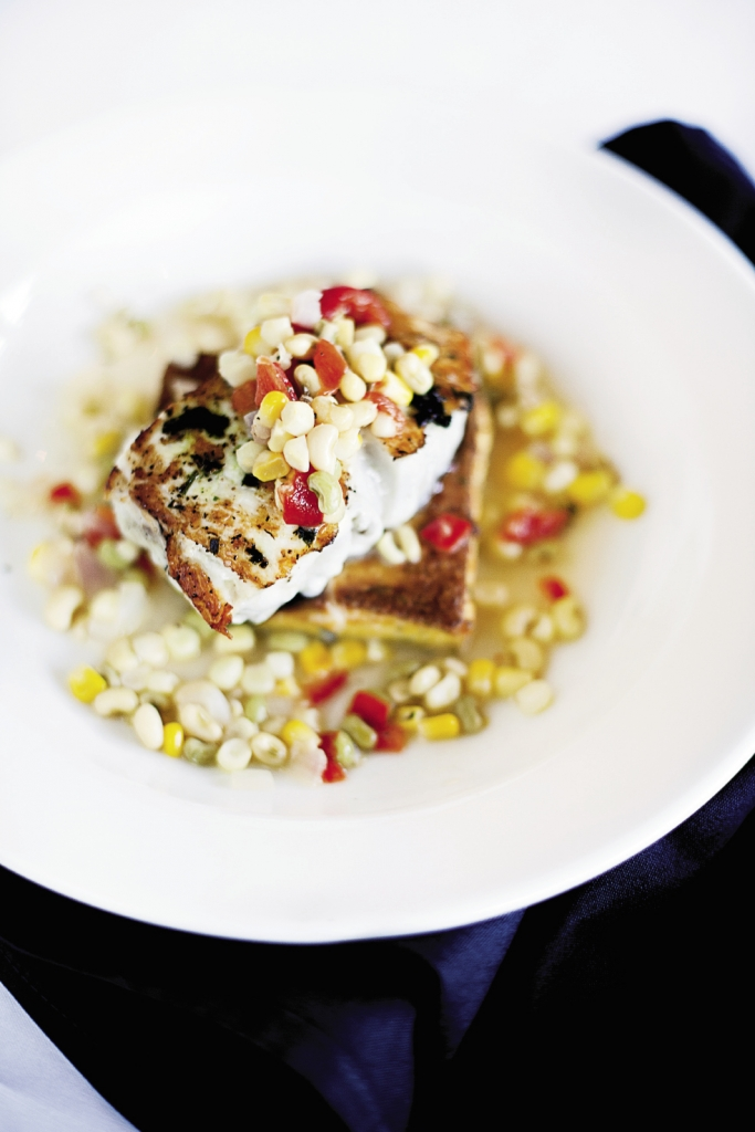 Pretty Tasty: Hog snapper may be an ugly fish, but once it's pan seared, placed on a grit cake and covered with succotash, it looks irresistible.