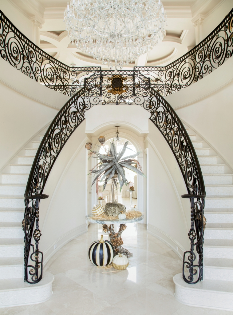 Stairway To Heaven: Making for a movie star grand entrance, the foyer features a double wrought iron staircase with Mother-of-Pearl risers, lit by lofty windows and a shimmering chandelier.