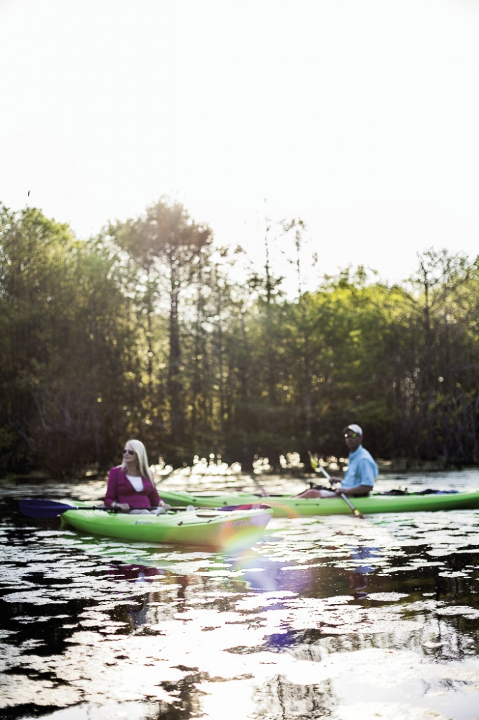 Kayakers sit in awe of the beauty that surrounds them.