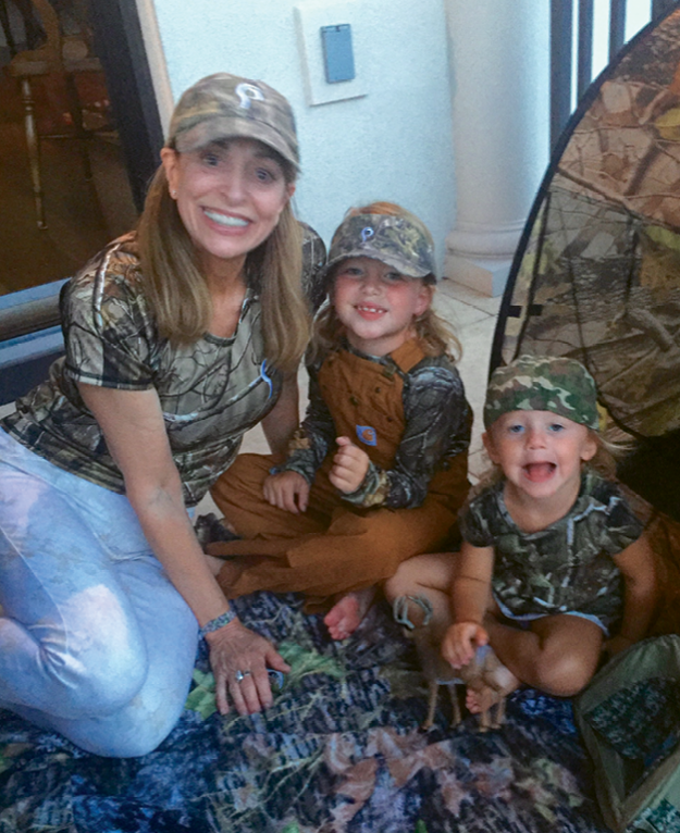 Her granddaughters, Gibbes, 6, and Caroline, 3, also love sporting camo from head to toe.