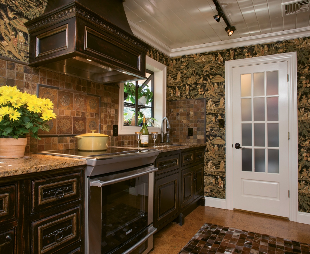 The kitchen is decked out with Habersham cabinetry, new cork flooring and a fetching animal hide patchwork rug.