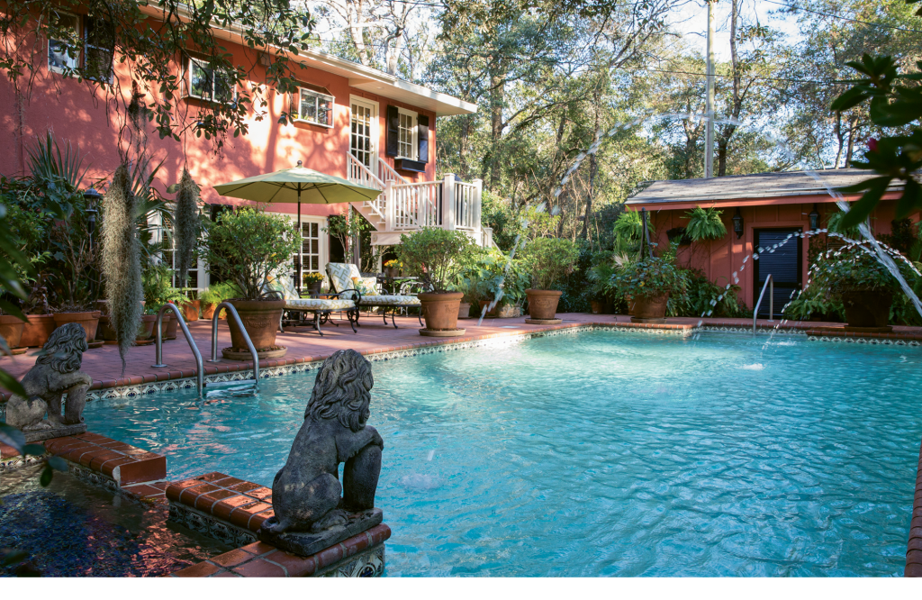 Like the interior of Gore's home, the outdoor grounds, pool and gardens create their own event.