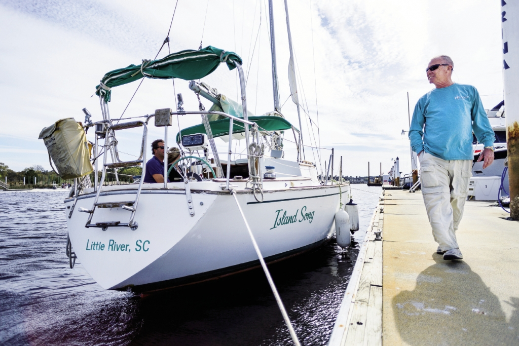 """The crew of the """"Island Song"""" prepares for a voyage out of Cricket Cove Marina in Little River."""