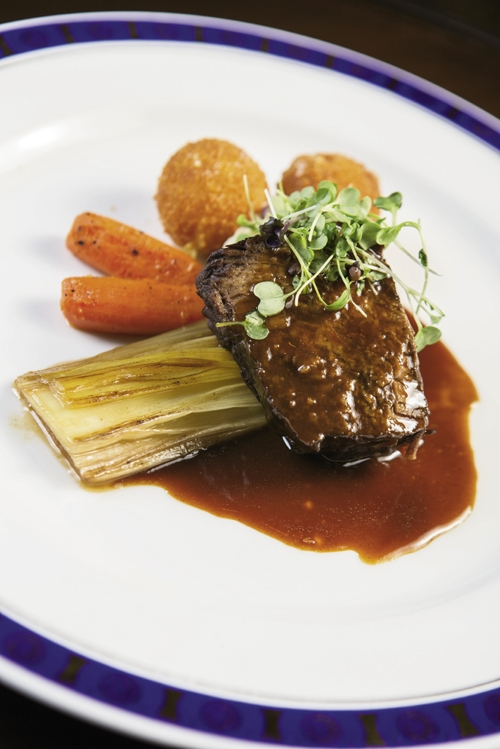 Seventh Course Up!: The meat course prepared by chef Mike McKinnon: Zinfandel-braised short ribs with a parsnip puree, caramelized leeks, roasted carrots and truffle potatoes.